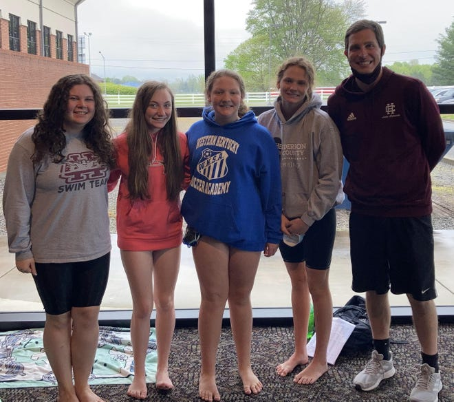 Henderson County High School swim team members, from left, Emily Marsh, Maggie Hollis, Lily Martin and Hannah Martin competed in Saturday's KHSAA state swimming and diving championships at Russell County High School in Russell Springs, Ky. They are pictured with Henderson County coach Ben Dempsey.