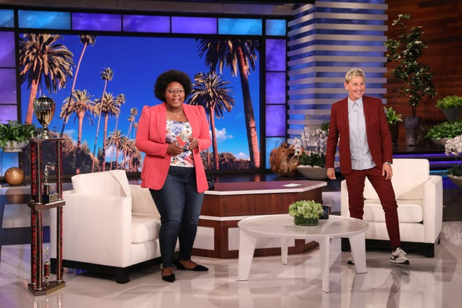 "Iowa City student Dasia Taylor,17, receives an award from Ellen DeGeneres.  In this photo released by Warner Bros., a taping of ""The Ellen DeGeneres Show"" is seen at the Warner Bros. lot in Burbank, Calif. (Photo by Michael Rozman/Warner Bros.)"