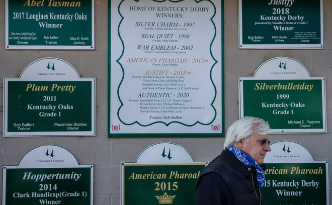 Trainer Bob Baffert talks with the media outside his stable at Churchill Downs last month.