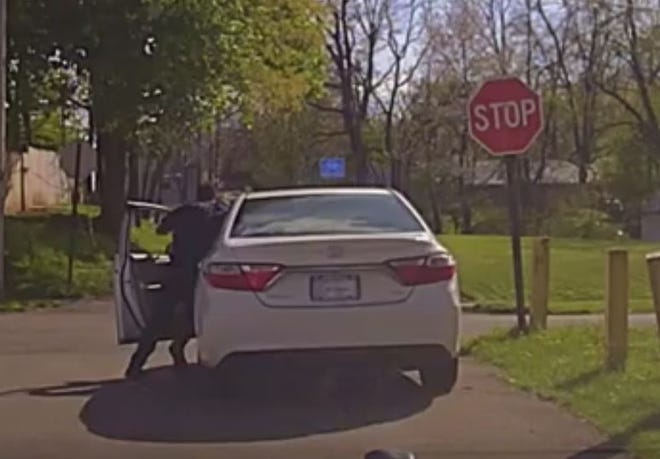 Mansfield police Officer Clay Blair is pushed out of a moving car by a driver after a traffic stop Sunday.