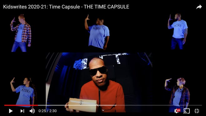 """A screenshot from the music video """"The Time Capsule,"""" written by fifth-grader  Jaden Bernal, composed by K.F. Jacques, lower center, and performed by Jacques and other Skylight Music Theatre artists."""