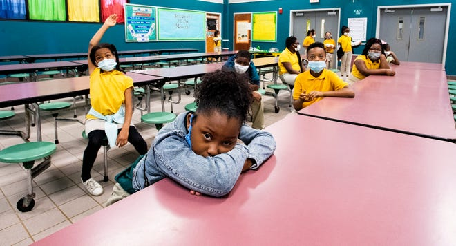 Christen Johnson and her classmates practice social distancing as they wait to pick up their lunches in the cafeteria at Carver Elementary Arts Magnet School in Montgomery, Ala., on April 26.