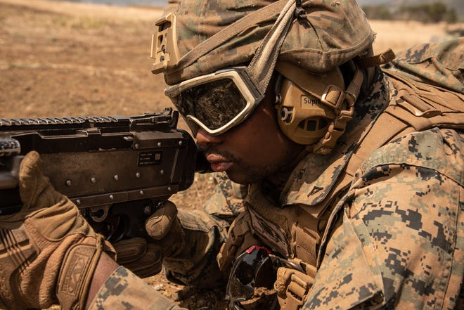 Tuskegee native U.S. Marine Corps Lance Cpl. Christopher Lester fires an M240B machine gun during Artillery Relocation Training Program 21.1 at Combined Arms Training Center, Camp Fuji, Japan, April 23.