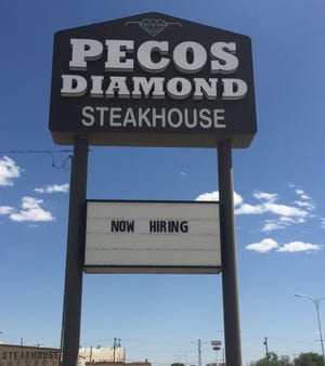 A sign at the Pecos Diamond Steakhouse in Artesia indicates they are hiring. According to the New Mexico Restaurant Association, hired help is hard to find.