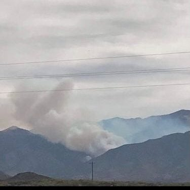 Smoke rises from the Three Rivers Fire that started on April 26, 2021.