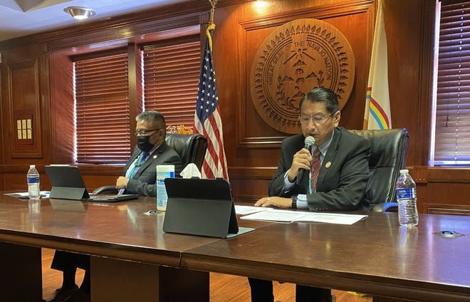 Navajo Nation President Jonathan Nez, right, and Vice President Myron Lizer give the State of the Nation address to the Navajo Nation Council at the spring session on April 19 from the presidential office in Window Rock, Arizona.