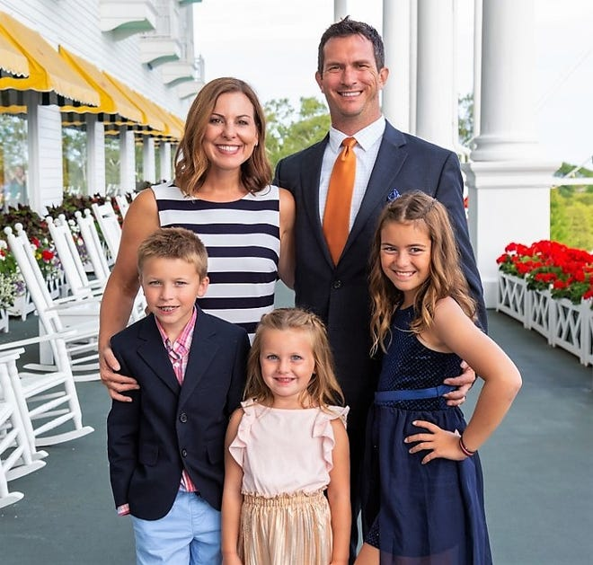 Recently-appointed Northville City Council member Andrew Krenz is pictured with his wife Kristine and their three children.