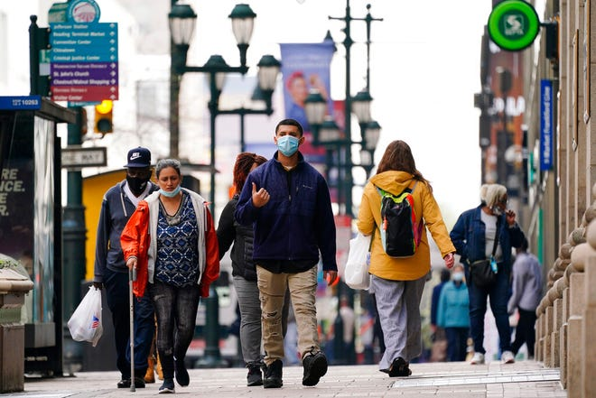 FILE - In this April 14, 2021 file photo people walk along Market Street in Philadelphia. Pennsylvania is expected to get the official word from the U.S. Census that its population growth continues to lag behind the nation's, marking the 10th consecutive decade the Keystone State has lost clout in Congress and presidential contests. (AP Photo/Matt Rourke, File)