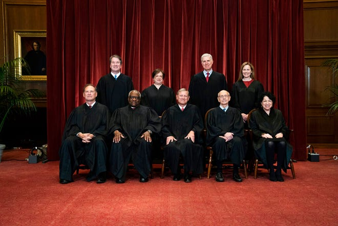FILE - In this April 23, 2021, file photo members of the Supreme Court pose for a group photo at the Supreme Court in Washington. Seated from left are Associate Justice Samuel Alito, Associate Justice Clarence Thomas, Chief Justice John Roberts, Associate Justice Stephen Breyer and Associate Justice Sonia Sotomayor, Standing from left are Associate Justice Brett Kavanaugh, Associate Justice Elena Kagan, Associate Justice Neil Gorsuch and Associate Justice Amy Coney Barrett. Before the Supreme Court this is week is an argument over whether public schools can discipline students over something they say off-campus. (Erin Schaff/The New York Times via AP, Pool, File)