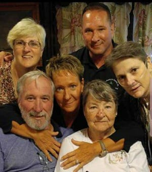 Keith Heacook, back right, with his siblings and mother. Clockwise from right: the late Beth Heacook, Anita Heacook, Kathy Heacook, Tom Heacook and Anita Feaster.