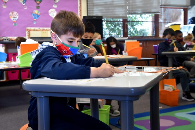 Preston Russell-Garris does school work in his kindergarten class at Mesa Union School in Somis on April 26 where the school recently expanded in-person instruction from two days a week to four.