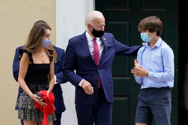 Joe Biden departs St. Joseph on the Brandywine Roman Catholic Church in Greenville with his grandchildren Natalie Biden, left, and Hunter Biden on Sunday, Sept. 13, 2020.