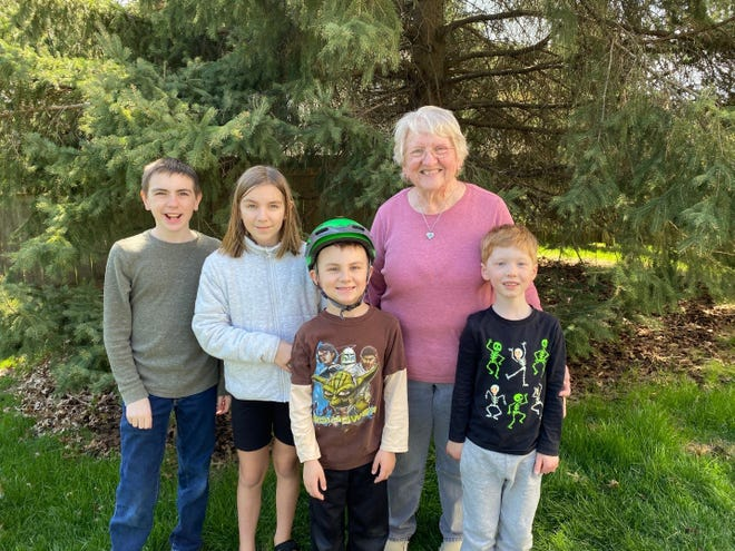 Together again. Susan is joined by her grandchildren, from left, Eli, Arianna, Wyatt and Harrison.