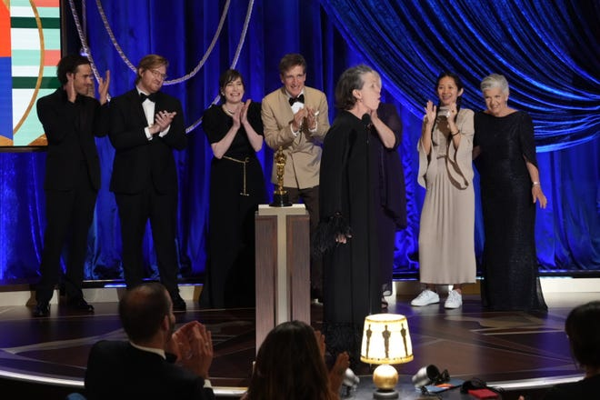 """Actress Frances McDormand, right forefront, howls like a wolf after the film """"Nomadland"""" won best picture. She was one of the producers of the picture."""