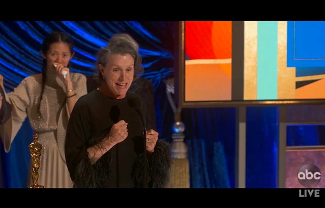"""Chloé Zhao, left, and Frances McDormand excitedly accept the best picture Oscar for """"Nomadland."""""""