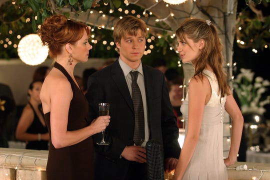 "Julie Cooper (Melinda Clarke) and her daughter, Marissa (Mischa Barton) trade glares, as Ryan (Ben McKenzie) is caught in the middle in an episode of ""The O.C."""