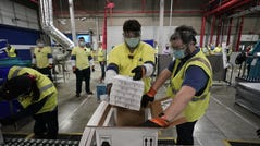 PORTAGE, MICHIGAN - DECEMBER 13: Boxes containing the Pfizer-BioNTech COVID-19 vaccine are prepared to be shipped at the Pfizer Global Supply Kalamazoo manufacturing plant on December 13, 2020 in Portage, Michigan. (Photo by Morry Gash - Pool/Getty Images)