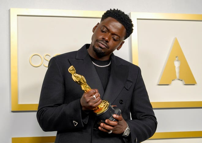 """Daniel Kaluuya, winner best supporting actor winner for """"Judas and the Black Messiah,"""" poses in the press room during the Oscars."""