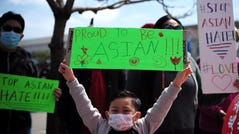 A boy holding a sign takes part in a Stop Asian Hate rally in Oakland, California, on April 3, 2021. (Photo by Wu Xiaoling/Xinhua via Getty)