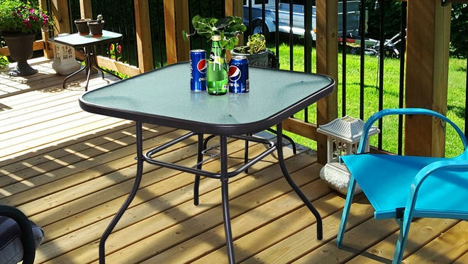 This 32-inch glass table is elevated for easy access.