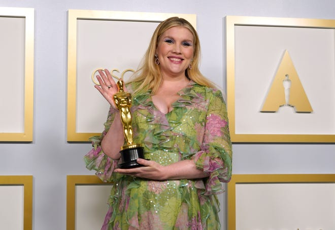 """Emerald Fennell, winner of the award for best original screenplay for """"Promising Young Woman,"""" poses in the press room at the Oscars on Sunday."""