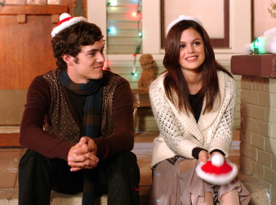 "Rachel Bilson with her former co-star and boyfriend, Adam Brody, in a scene from classic 'The O.C."" episode ""The Chrismukkah that Almost Wasn't."""