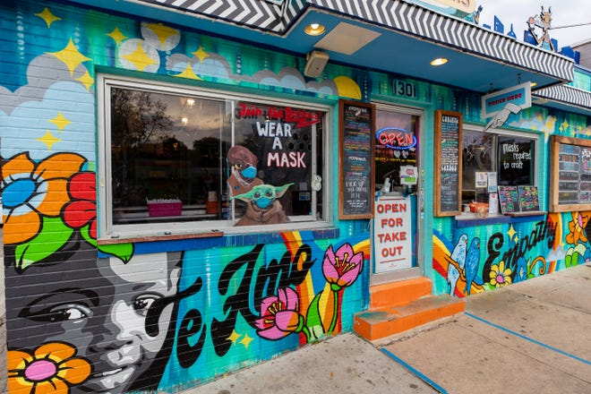"""The Kindness Campaign created a mural at the Amy's Ice Creams on South Congress Avenue that took the words people submitted to answer the question: """"What does kindness mean to you?"""" Artists Phoebe Joynt and Niz were chosen to complete the mural."""