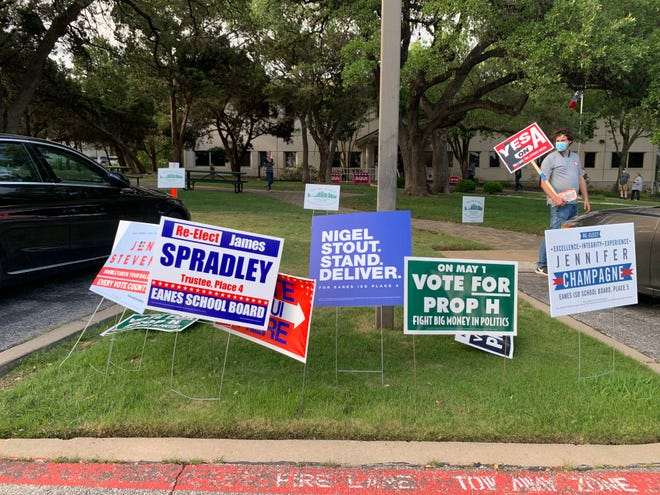 The race for Eanes school board is very contentious this spring, with incumbents Jennifer Champagne and James Spradley running against Jennifer Stevens and Nigel Stout, respectively. The lawn outside the district's central administration building, where the community can vote early, is covered in campaign signs.