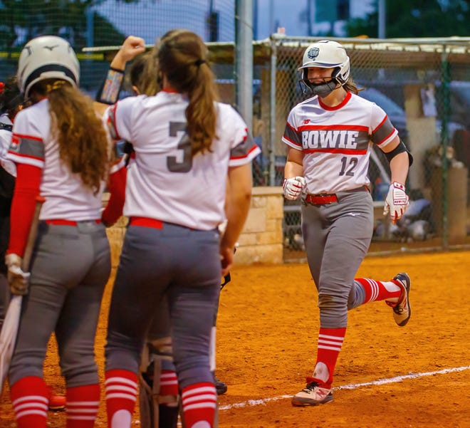 Bowie's Anya German, right, shown in a game earlier this season, belted a walk-off grand slam with one out in the bottom of the seventh to give the Bulldogs the district title Monday with a 6-3 over Hays in the district championship game. German, a freshman, ended the game 2-for-4 with five RBIs.