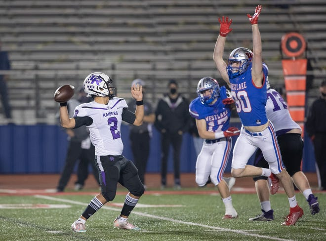 Westlake defensive end Ethan Burke, right, pressures Cedar Ridge quarterback Joaquin Sandoval during a first-round playoff game by the Chaps last season. Burke will be one of several defensive linemen that will step into a starting role.