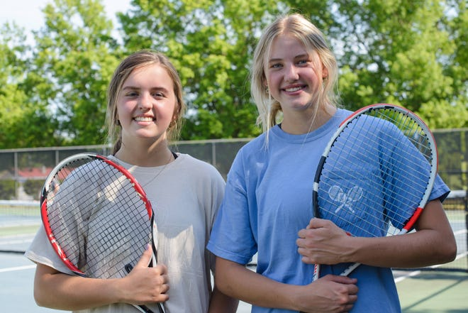 Isabella Miller, left, and Brinley Bartlett, right, both freshmen tennis players on the Oconee County girls tennis team are part of the No. 1 doubles team, Bartlett is the No. 1 singles player on the team. (Julian Alexander for the Athens Banner-Herald)