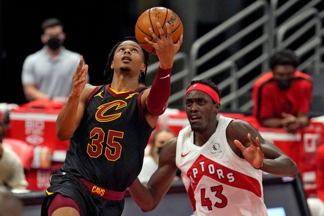 Cleveland Cavaliers forward Isaac Okoro (35) goes for a layup after driving around Toronto Raptors forward Pascal Siakam (43) during the second half of an NBA basketball game Monday, April 26, 2021, in Tampa, Fla. (AP Photo/Chris O'Meara)