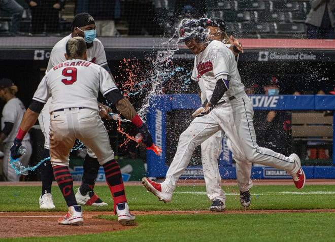 Cleveland's Jordan Luplow gets drenched by Eddie Rosario and his teammates after hitting a two-run home run off Minnesota Twins relief pitcher Alex Colome during the tenth inning of a baseball game in Cleveland, Monday, April 26, 2021. [Phil Long/Associated Press]
