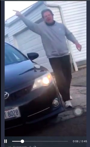 This screenshot of a video taken by a Black DoorDash driver allegedly shows James Rhodes threatening the driver using racial slurs.