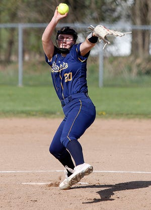 Hillsdale High School's Bryn Grabowski (20) delivers a pitch against Northwestern High School during high school softball action Tuesday, April 27, 2021 at Northwestern High School. TOM E. PUSKAR/TIMES-GAZETTE.COM