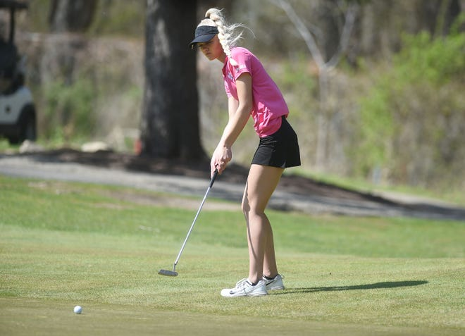 Nevada's Ashlynn Sporrer looks at the ball after a putt onto the fourth hole during the Ames Turk Bowman Invitational at the Veenker Memorial Golf course in Ames Monday.