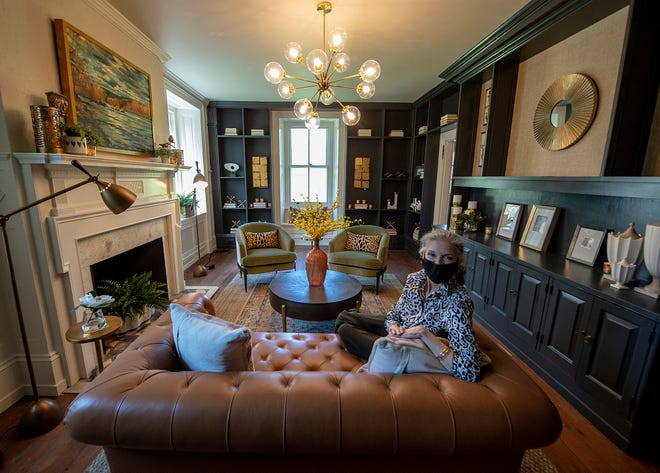 """Victoria Guillot, owner/designer of Stage Coach Services Design, of Doylestown, sits in her """"A Peaceful Haven"""" room, at the 46th Bucks County Designer House at Mearns Mill Manor in Warminster,"""