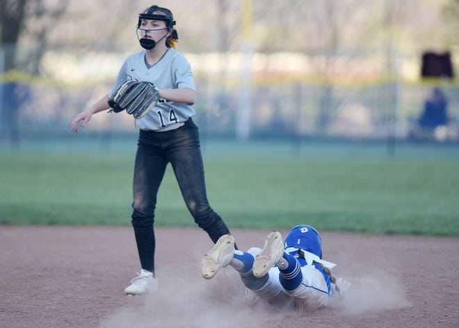 Ellwood's Makinley Magill slides safely into second as Keystone Oak's  Leah Harmel waits for the ball during Monday's game at Stiefel Park.