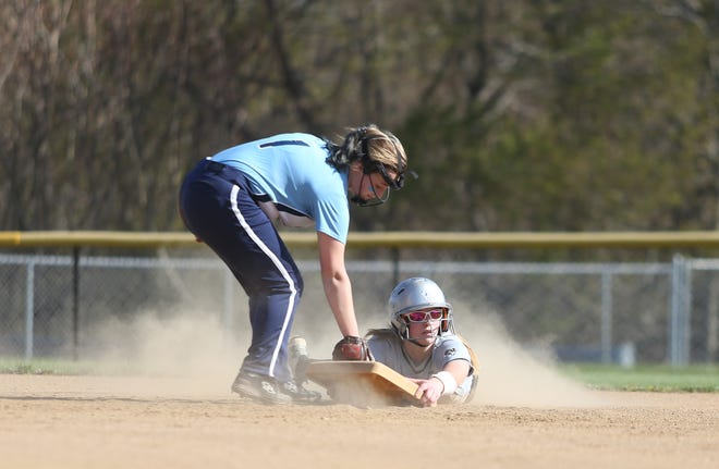 South Side's Laney Lewis (24) takes second base with her after over sliding while Bishop Canevin's Bella Demark (1) holds the tag during the third inning Monday evening at South Side High School.
