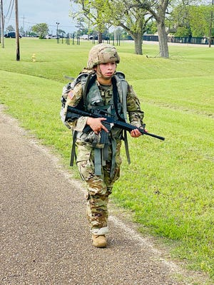 Spc. Vanessa Mundell completes the 12-mile foot march during the Bayne-Jones Army Community Hospital Soldier and Noncommissioned Officer of the Year competition April 15 at the Joint Readiness Training Center and Fort Polk.