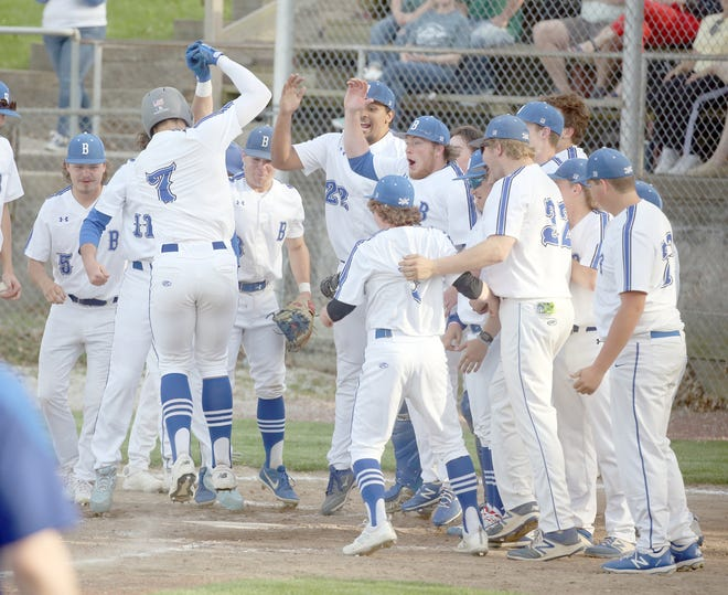 Boonville junior Jamesian McKee was greeted by his teammates after hitting a two-run home run in the second inning Monday night against Rock Bridge at Twillman field in Harley park. The Pirates fell to Rock Bridge 12-8, dropping to 7-5 on the season.