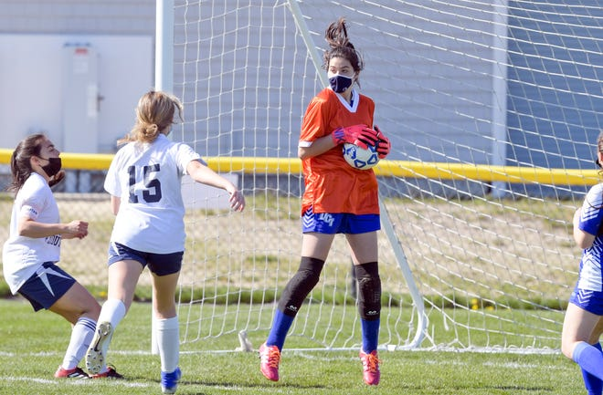 Upper Cape goalie Haley King stops a shot in front of Sadie Clement of Bristol-Plymouth in Tuesday's game.