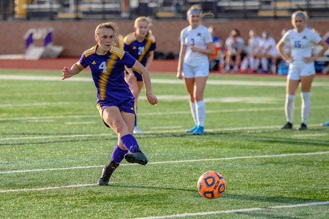 Hickman's Ava Hoenes (4) shoots a penalty kick for the only goal during a 1-0 victory over Capital City on Monday at Hickman High School.
