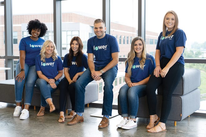 Lower.com employees (shown here pre-pandemic) response to an employee satisfaction survey earned the company a top ranking among large companies in Columbus CEO's Top Workplaces 2021 awards.