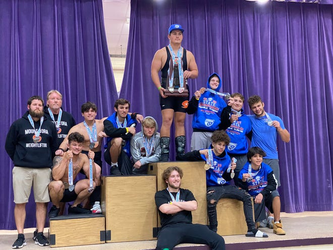 Mount Dora High School weightlifters celebrate their solid performance at the recent Florida High School Athletic Association Class 1A state finals at Port St. Joe High School. [COURTESY}