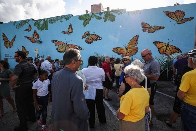 The mural of monarch butterflies, painted by artist Courtney Canova, is one of several murals in DeLand's downtown. The mural recognizing the city's designation as the state's first Monarch City USA was unveiled in 2019.