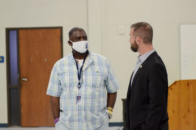 """Ascension Parish Council members Alvin """"Coach"""" Thomas and Joel Robert chat during an open-house event for the parishwide sewer proposition."""