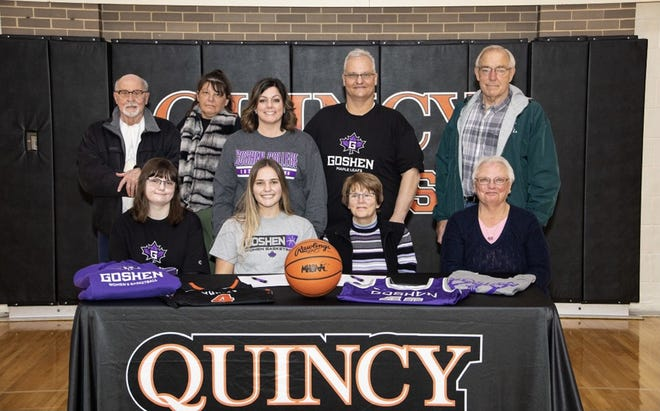 Quincy senior Hannah Clark recently signed her letter of intent to play basketball at Goshen College. Here Clark is joined by her family at the signing ceremony.