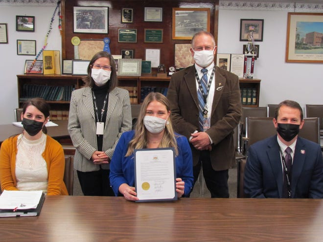 The Wayne County Board of Commissioners joined with the District Attorney and representatives of Children and Youth Services to raise awareness about the dangers of child abuse and the successes the county has had rooting it out over the last 12 months. Seated left to right: Stephanie Bryant, Rozalyn Burke and A.G. Howell. Standing left to right: Jocelyn Cramer and Brian Smith.