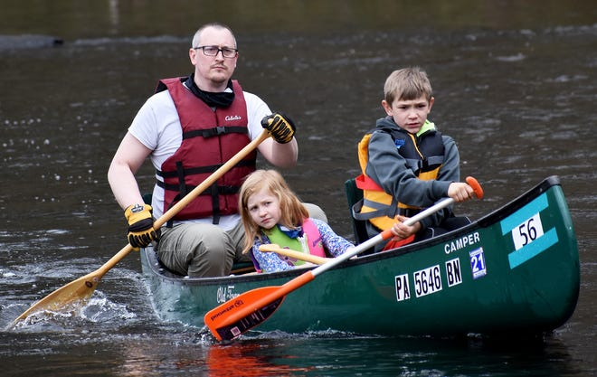 """Three members of """"Team Schuman"""" have their eyes focused on the prize as they power down the Lackawaxen Sunday afternoon at the Wayne County Canoe Classic. The event has been sponsored each spring by the Honesdale Area Jaycees since 1981."""
